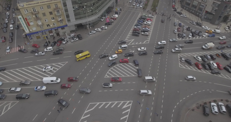 Aerial view of the road intersection, traffic at rush hour with cars on the road. Victory Square in the city of Kiev overloaded with public transport. 19. May. 2019. Filmed from 4K drone in RAW. Video #1030864007
