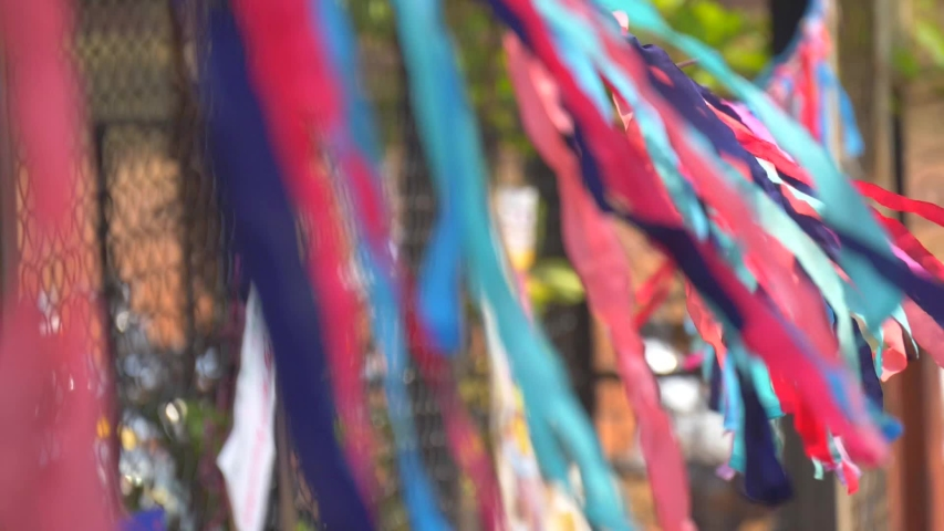 Bright colored ribbons fluttering in the wind. Multicolored ribbons sway in the wind. India, GOA. | Shutterstock HD Video #1030904624