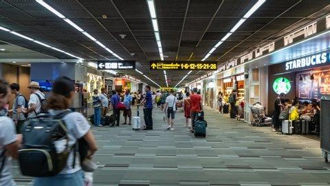 BANGKOK, THAILAND - MAY 15, 2019: Hyperlapse of Many Passengers Walk along Terminal. Crowd of People in International Airport of Bangkok
