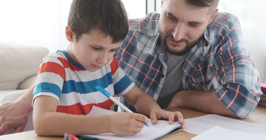 Father helping his son doing homework | Shutterstock HD Video #1030979840
