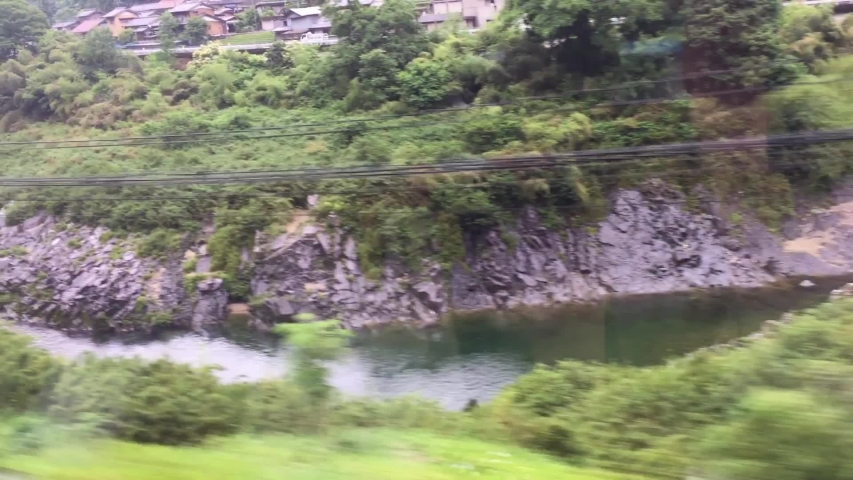 Japanese mountain traines along the course of the river | Shutterstock HD Video #1031010182