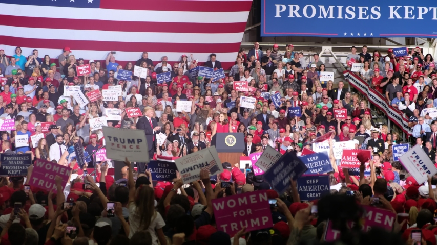 "MESA, ARIZONA. October 2018. Trump Rally - Crowd chants ""Build The Wall""."
