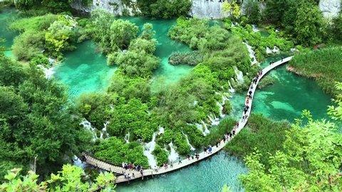Blue water lakes. People walking in national park.