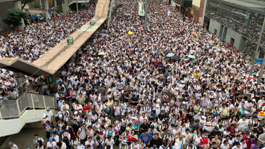 Hong Kong- June 9 2019: the crowd protest in the rally. More than 150,000 protesters took to the streets of Hong Kong Sunday to oppose a controversial extradition bill  | Shutterstock HD Video #1031064452