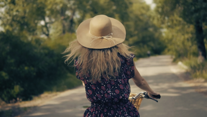 Cyclist Happy Woman In Hat Hair Blowing.Beautiful Girl Wearing Dress On Bike.Slow Motion Hair Flowing.Cycling Pretty Girl In Hat Vacation Holiday Fun Sport.Happy Cyclist Bike Leisure Workout Exercise