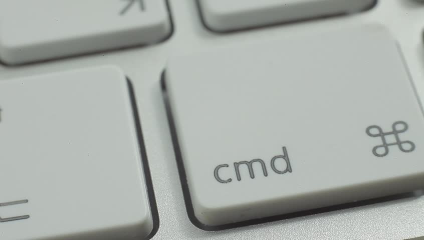 Finger Push Command (Cmd) Key Button of the Keyboard. Close up slow panorama. Macro shot. #10310960