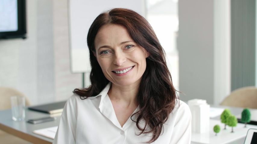 Smiling, mature businesswoman in the office    Shutterstock HD Video #1031102930