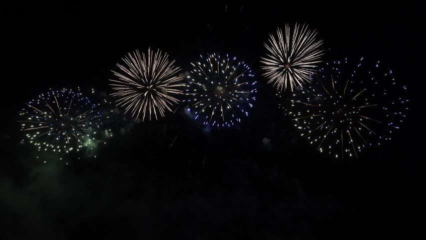 Real Fireworks on Deep Black Background Sky on Fireworks festival show before independence day on 4 of July | Shutterstock HD Video #1031160125