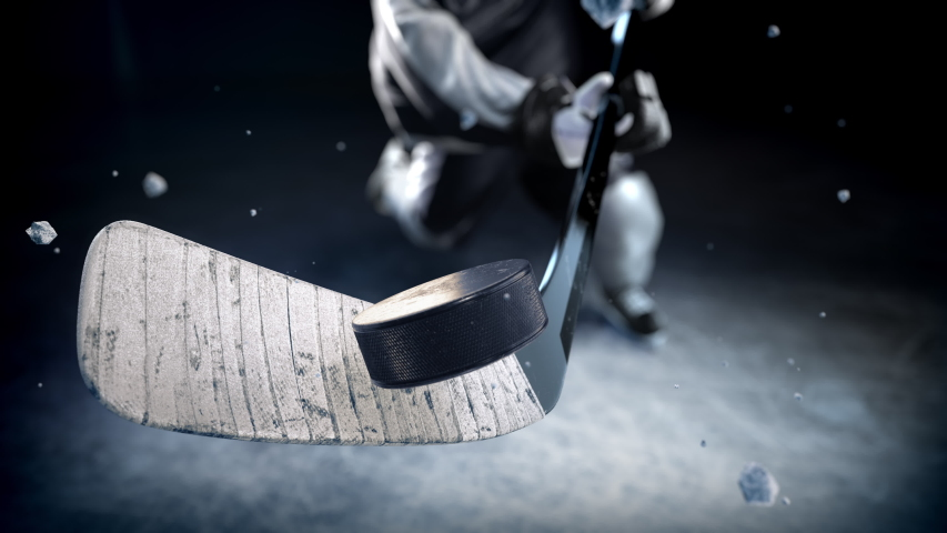 Hockey player in black uniform hits the puck in slow motion. Beautiful close-up (4k, 3840x2160, ultra high definition)