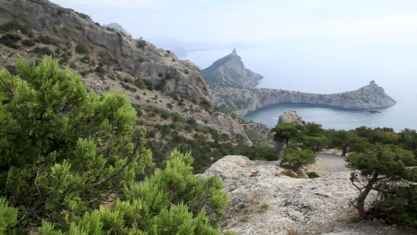 Cape Capchik between the mountain Eagle and Caraul-Oba. Separates Blue and Light Blue bays. Crimea, Novyi Svit. | Shutterstock HD Video #1031183717