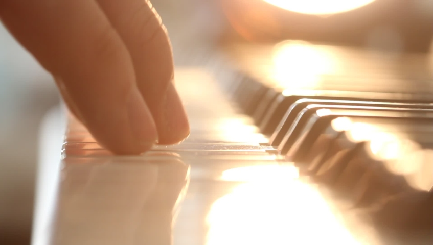 Man's hands  playing electrical piano near the window in the morning. Pleasant sunshine light from a window indoors. | Shutterstock HD Video #1031186735