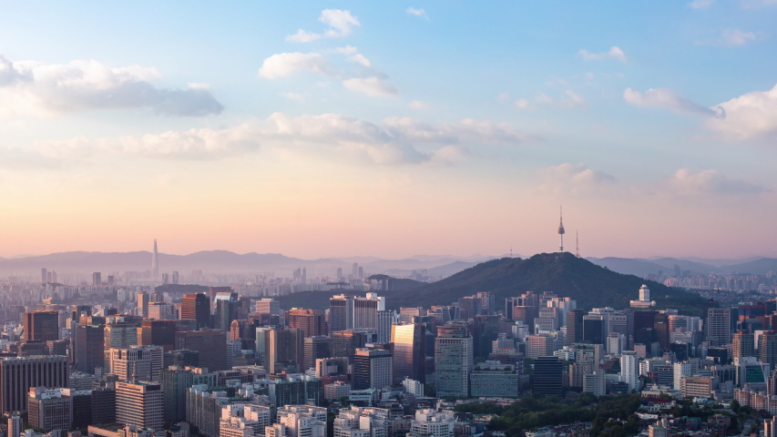 Seoul city skyline and Seoul tower modern building and architecture, Beautiful clouds flow through the Seoul tower in the morning in downtown Seoul, South Korea. 4k timelapse