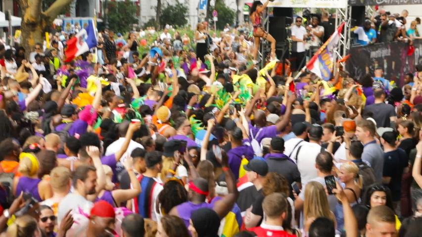 Berlin, Germany - June 9, 2019: Carnival of Cultures Parade Karneval der Kulturen Umzug - a multicultural music festival in Kreuzberg. Video footage. crowd dancing of diverse nationalities near the