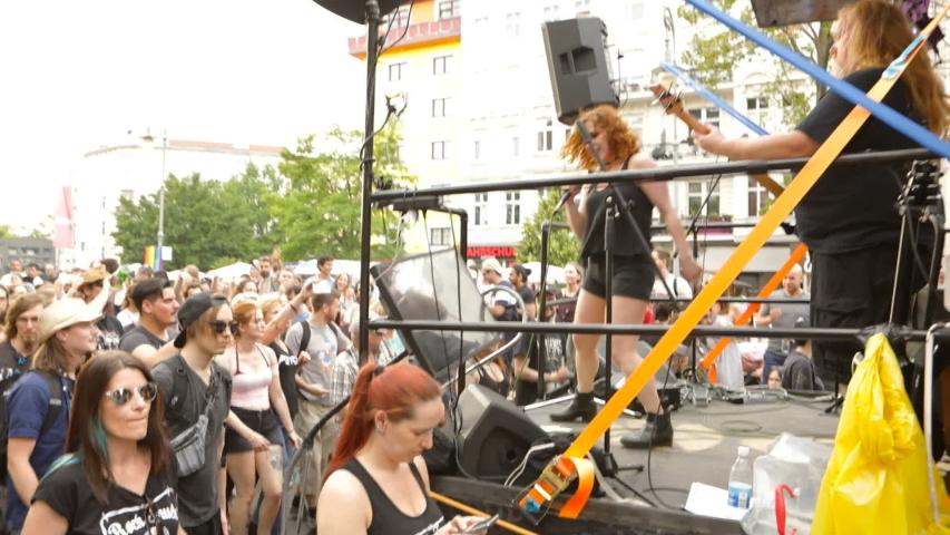 Berlin, Germany - June 9, 2019: Carnival of Cultures Parade Karneval der Kulturen Umzug - a multicultural music festival in Kreuzberg. Video footage. Rockers crowd dancing near the moving truck. heavy