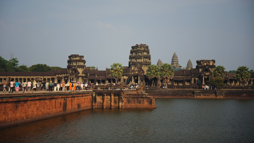 ANGKOR, CAMBODIA - FEBRUARY 16, 2011 Time Lapse of Angkor Wat Temple Entrance People Visit World's Largest Building