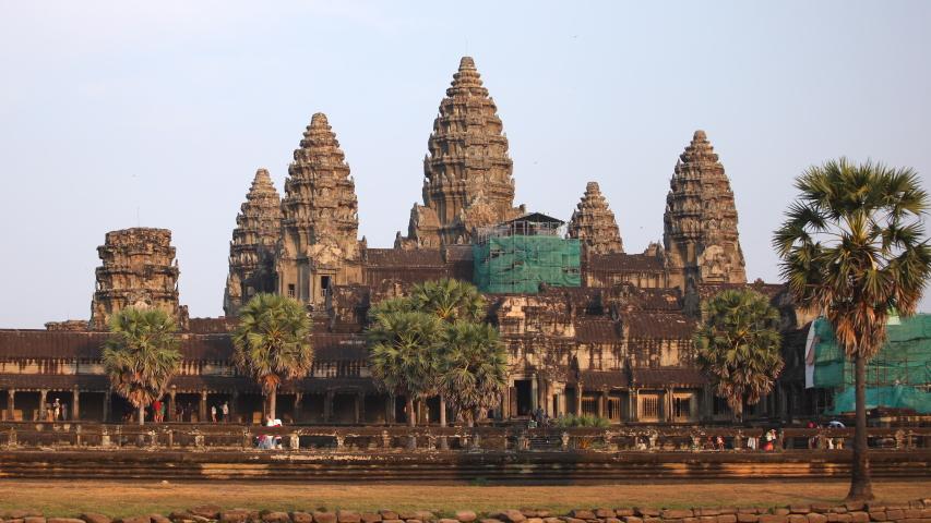 ANGKOR, CAMBODIA - FEBRUARY 16, 2011 Time Lapse Angkor Wat Temple Crowd of People Visit Iconic Landmark Sunset Light