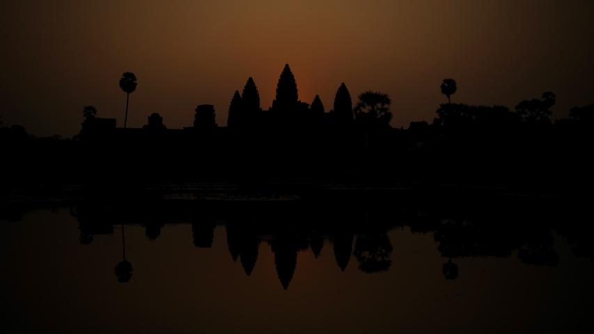 ANGKOR, CAMBODIA - FEBRUARY 16, 2011 Sunrise Time Lapse Angkor Wat Temple Cambodia Symbol Iconic Buddhism Landmark