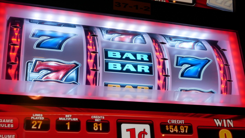 Coquitlam, BC, Canada - May 31, 2019 : Motion of people playing slot machine inside Casino, focus on screen with 4k resolution