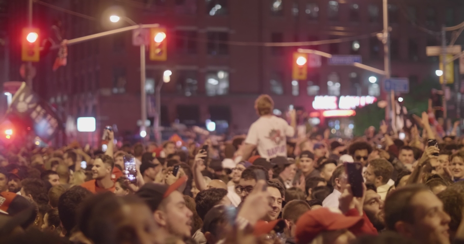 TORONTO - JUNE 13TH: Toronto Raptors fans celebrate their team's historic win in the NBA finals as seen on June 13th, 2019 in Toronto, Canada.