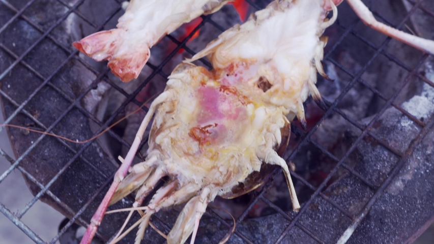 Grill Shrimp seafood on outdoor look tasty 4K. | Shutterstock HD Video #1031412593