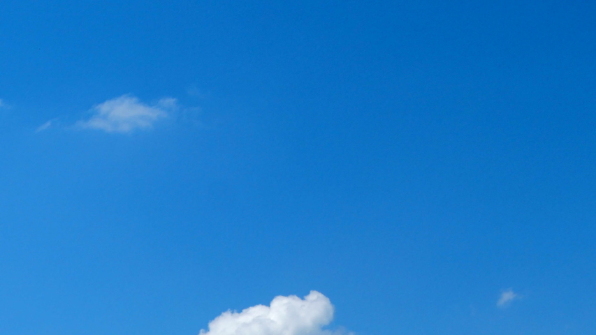 Nature, solar energy and spiritual concept - Blue sky background, white clouds and bright sunlight #1031420702