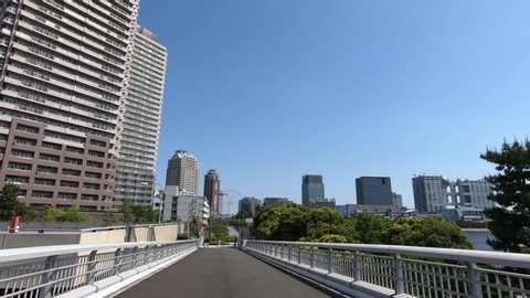 A sunny day, a place where you can see the tower apartment.
