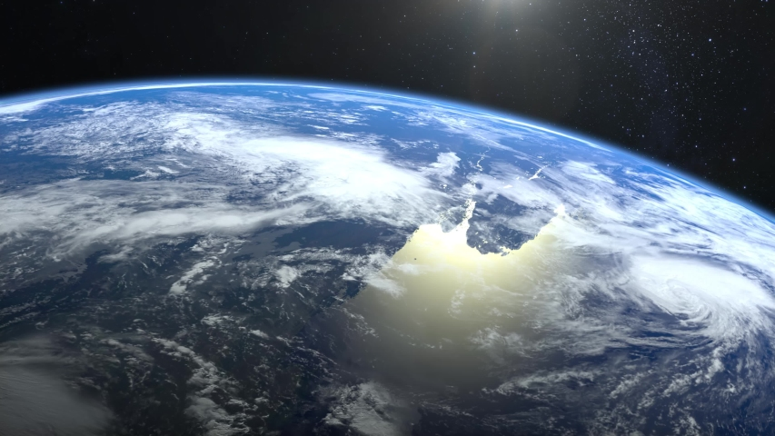 Earth. View from space. The camera approaches the Earth and rotates to the left. Stars twinkle. 4K. Realistic atmosphere. 3D Volumetric clouds. The sun is in the frame. | Shutterstock HD Video #1031453015