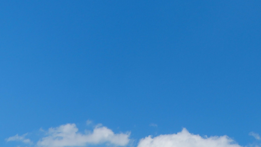 Nature, solar energy and spiritual concept - Blue sky background, white clouds and bright sunlight #1031457665