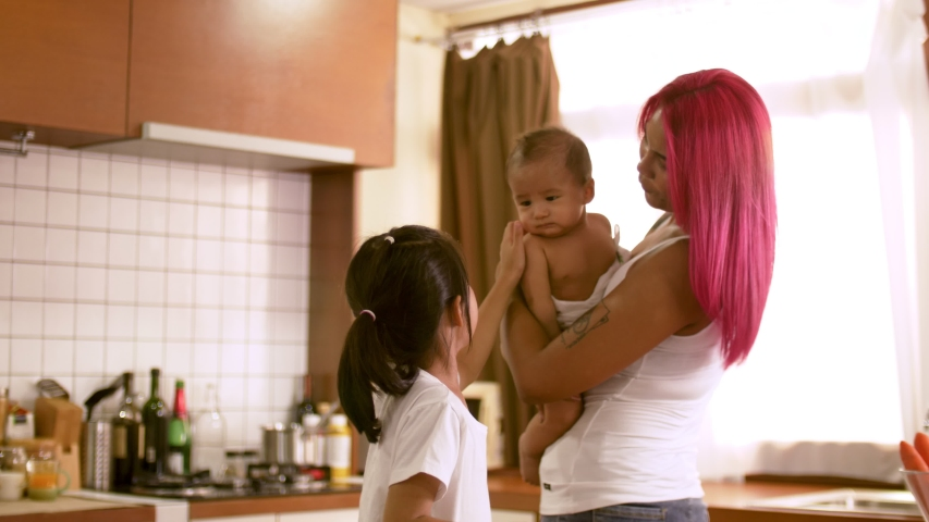Happy young mother and kids spending time together at home | Shutterstock HD Video #1031494742
