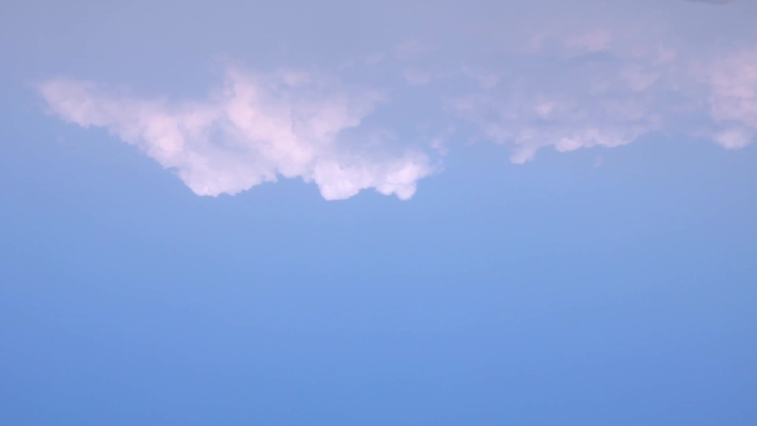 Aerial view vertical time lapse white sunny, summer clouds, very beautiful blue clean skies in horizon, nature big mass fast motion fluffy, puffy fast motion cloudscape. /UHD.   Shutterstock HD Video #1031498033