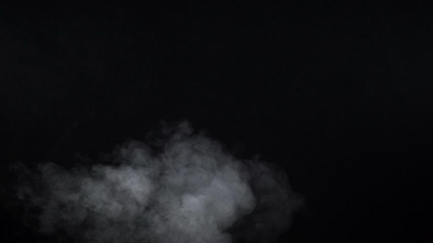 Shooting of white cigarette steam on black background | Shutterstock HD Video #1031501780
