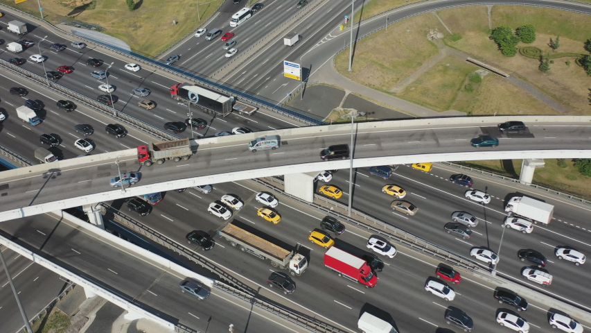 View from the air on the movement of cars on the overpasses at the intersection with the ring road and the exit from the city #1031503427