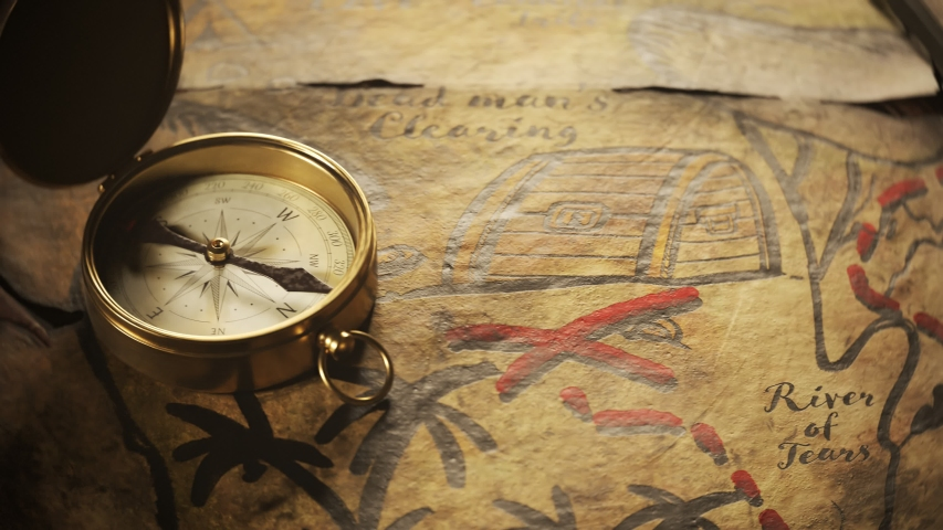 Old, worn, translucent, handmade drawn treasure map on a wooden tavern table with sword and compass on top of it. Close up camera follows the red dashed line until it reaches the x spot.  | Shutterstock HD Video #1031514779