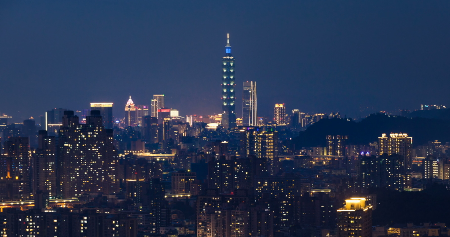 Beautiful aerial time lapse view of Taipei city during day to night