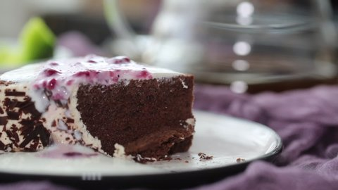 eating chocolate mousse cake with spoon
