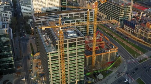 Aerial view of construction cranes and building construction in the center of Warsaw, Poland