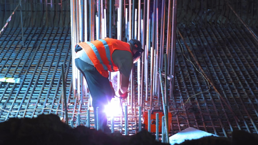 Construction site of Shulyavskiy bridge in Kyiv, Ukraine 6 of june 2019 Workers construct at night in led lights.