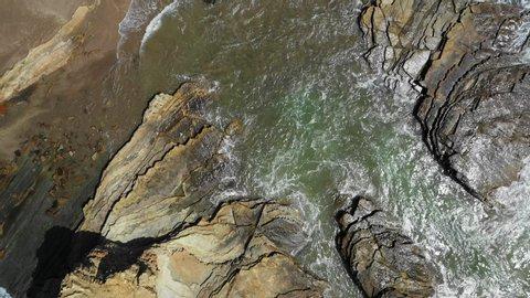 Aerial Ascend: Sunny Ocean Waves On Rocky Shore - El Gigante, Nicaragua
