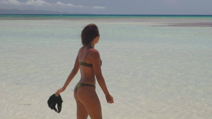 Slow Motion: Beautiful Woman in Bikini Walking Towards Camera with Ocean Behind - Cayo Arena, Dominican Republic