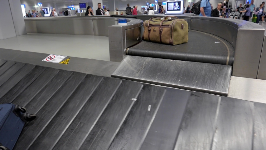 FRANKFURT, GERMANY - JUNE 10,2019: Baggage carousel at the Frankfurt International Airport | Shutterstock HD Video #1031660633