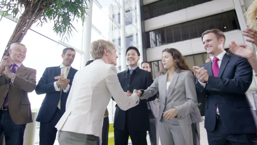 4k Confident diverse business team applauding their success and shaking hands with the boss | Shutterstock HD Video #10316909