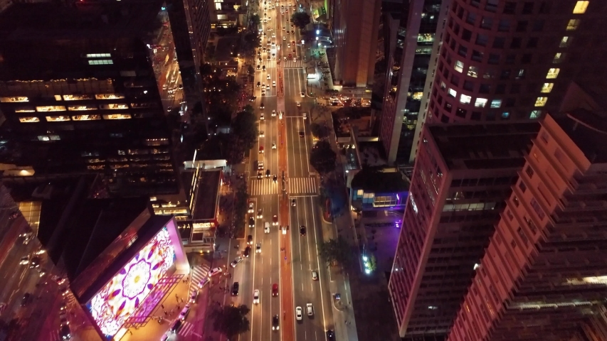 Top view of Paulista Avenue, São Paulo, Brazil. Night's scenery. Downtown's scene.  Landmark of the city, Heart of São Paulo. Colored scenery. | Shutterstock HD Video #1031694230