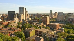 Late afternoon drone footage of Providence, Rhode Island with uplift camera motion from Prospect Terrace park, revealing the city skyline. Providence is the capital of Rhode Island.