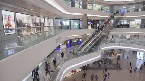 Hong Kong - May 5, 2019: Main atrium of Times Square in Causeway Bay. Accelerated time. Visitors moving between floors of the shopping center. Hong Kong is a popular tourist destination of Asia.