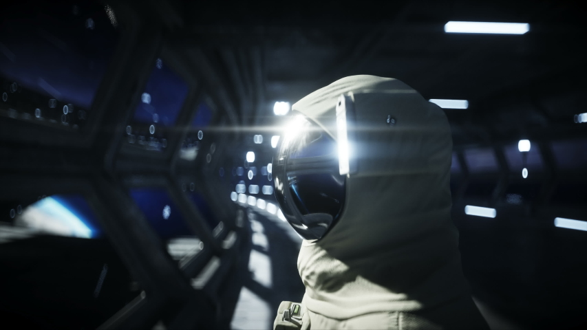 Alone astronaut in futuristic space corridor, room. view of the earth. cinematic 4k footage. | Shutterstock HD Video #1031756162
