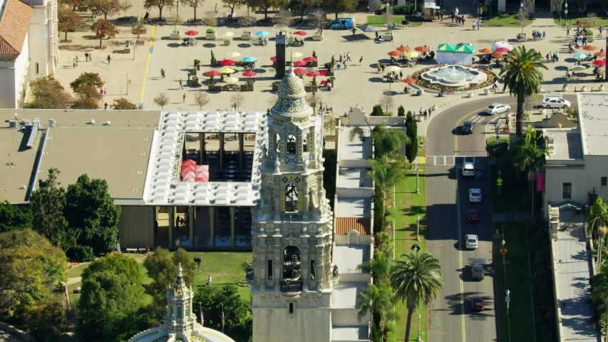 Aerial view of Balboa Park square ornate California Tower and Historic dome San Diego Pacific ocean Southern California USA RED WEAPON | Shutterstock HD Video #1031759816