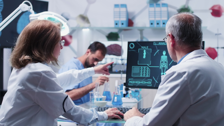 Team of scientists working in advanced busy laboratory   Shutterstock HD Video #1031796029