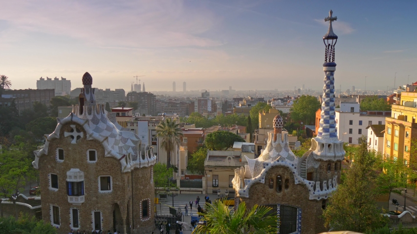 Steadicam shot of Park Guell and city of Barcelona, Spain. Bright colored mosaic is seen in the foreground. UHD Royalty-Free Stock Footage #1031821349