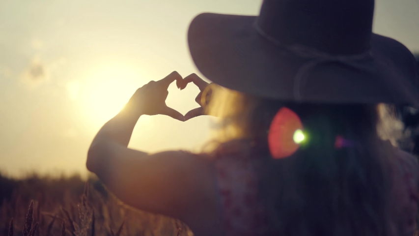 Girl Made Love Heart From Finger.Woman In Hat Enjoying Sun.Lady Making Heart Shape With Hands.Glare Of Summer Sun On Hands.Sun Rays On Morning Weekend.Vacation Holidays Time.Love Hearth Signs Symbols   Shutterstock HD Video #1031840687
