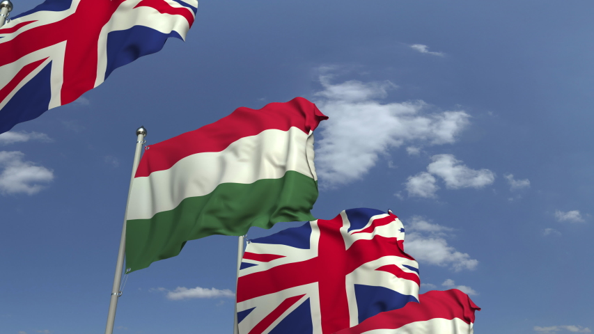 Row of waving flags of Hungary and the United Kingdom, loopable 3D animation   Shutterstock HD Video #1031842388
